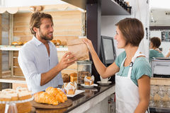 Pretty waitress serving happy customer Royalty Free Stock Photo
