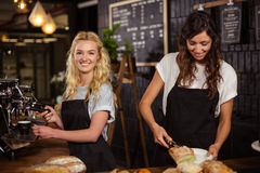 Pretty waitresses behind the counter working Stock Photo