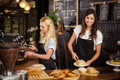 Pretty waitresses behind the counter working Stock Image