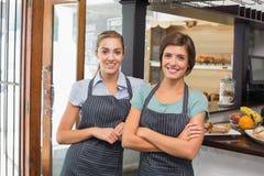 Pretty waitresses smiling at camera Stock Photo