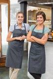 Pretty waitresses smiling at camera Royalty Free Stock Photos
