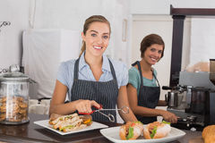 Pretty waitresses working with a smile Stock Images