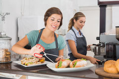 Pretty waitresses working with a smile Royalty Free Stock Photo