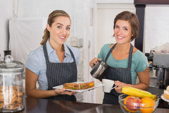 Pretty waitresses working with a smile Stock Image