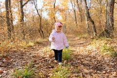 Pretty Walking Girl. Pretty girl walking in forest with toy mouse Royalty Free Stock Photo