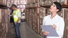 Pretty warehouse manager checking inventory Stock Images