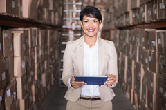 Pretty warehouse manager holding tablet pc royalty free stock photo