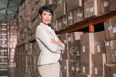 Pretty warehouse manager smiling at camera Royalty Free Stock Photography