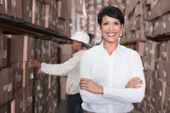 Pretty warehouse manager smiling at camera Stock Images