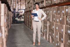 Pretty warehouse manager using tablet pc Stock Image