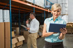 Pretty warehouse manager using tablet pc Royalty Free Stock Photo