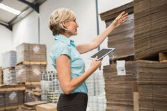 Pretty warehouse manager using tablet pc Stock Photos