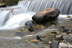 Pretty waterfall on rock stones Stock Images
