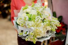 Pretty wedding bouquet of beautiful flowers in woman hands Stock Images