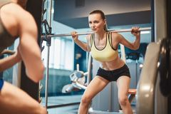 Pretty weightlifter Royalty Free Stock Photos