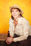 Pretty Western Woman with Beer Royalty Free Stock Photo