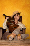 Pretty Western Woman with Guitar Royalty Free Stock Photography