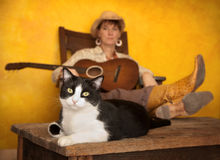 Pretty Western Woman with Guitar and cat royalty free stock image