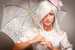 Pretty White Haired Woman with Parasol Royalty Free Stock Images