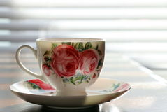 Pretty white tea cup with team. Stock Photography