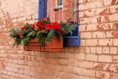 Pretty window box with holiday arrangement Royalty Free Stock Image