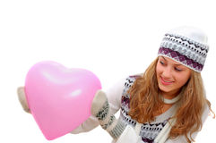 Pretty winter dressed teenage girl with pink heart Stock Photography