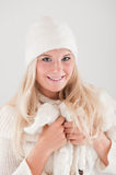 pretty winter girl in white hat and scarf Royalty Free Stock Image