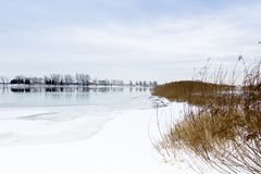 Pretty winter view of the St.Lawrence River seen from the east sector of Montreal stock photography