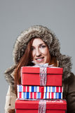 Pretty winter woman carrying Christmas gifts Royalty Free Stock Photography