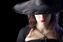 Pretty Witch. On Black Background Royalty Free Stock Photography