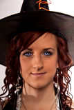 Pretty Witch. Red headed witch, with blue eys and hat Stock Photography