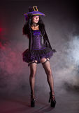 Pretty Witch In Purple And Black Gothic Halloween Costume Royalty Free Stock Photos