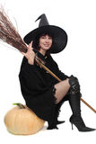 Pretty witch sitting Stock Photography
