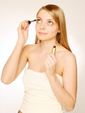 Pretty woman. Applying make up Royalty Free Stock Photography
