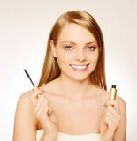 Pretty woman. Applying make up Stock Image