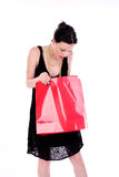 Pretty woman. Girl looking in to a bag Royalty Free Stock Photo