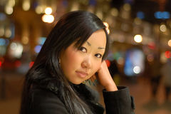 Pretty woman. Pretty asian woman at night outdoors stock images