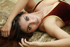 Pretty woman. Lie down outsoor Royalty Free Stock Photography