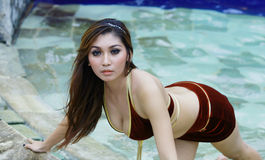 Pretty woman. Portrait of pretty woman at pool Royalty Free Stock Images