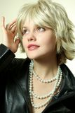 Pretty woman. S portrait with pearls Royalty Free Stock Photos