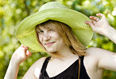 Pretty woman. Young beautiful girl in straw hat stock photo