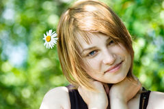 Pretty woman. Beauty woman portrait with camomile flower stock images