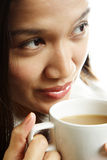 Pretty woman. A beautiful woman drinking a hot cup of coffee Stock Images