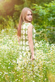 Pretty woman. Young happy girl with bouquet in flowers field stock images