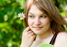 Pretty woman. Beauty woman portrait with camomile flower stock photos