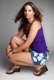Pretty Woman. Pretty fashion model woman crouching Royalty Free Stock Image