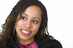 Pretty woman. Pretty Afro-American woman with pink t-shirt and black jacket, smiling and looking to the side Stock Images