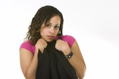 Pretty woman. Pretty Afro-American woman being shy and clutching her jacket to her chest Stock Photo