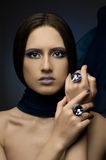Pretty woman. The very  pretty woman with dark blue neckerchief,  rings with huge blue brilliant, sensual sexuality gaze Royalty Free Stock Photo