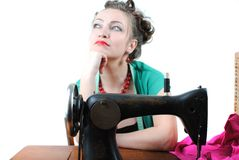 Pretty woman. Using a sewing machine royalty free stock image